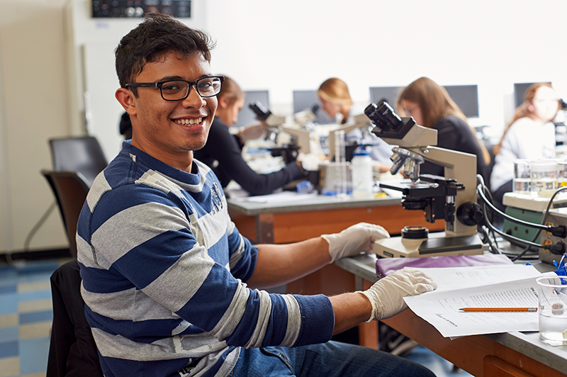 Adelphi Science student smiles in the classroom